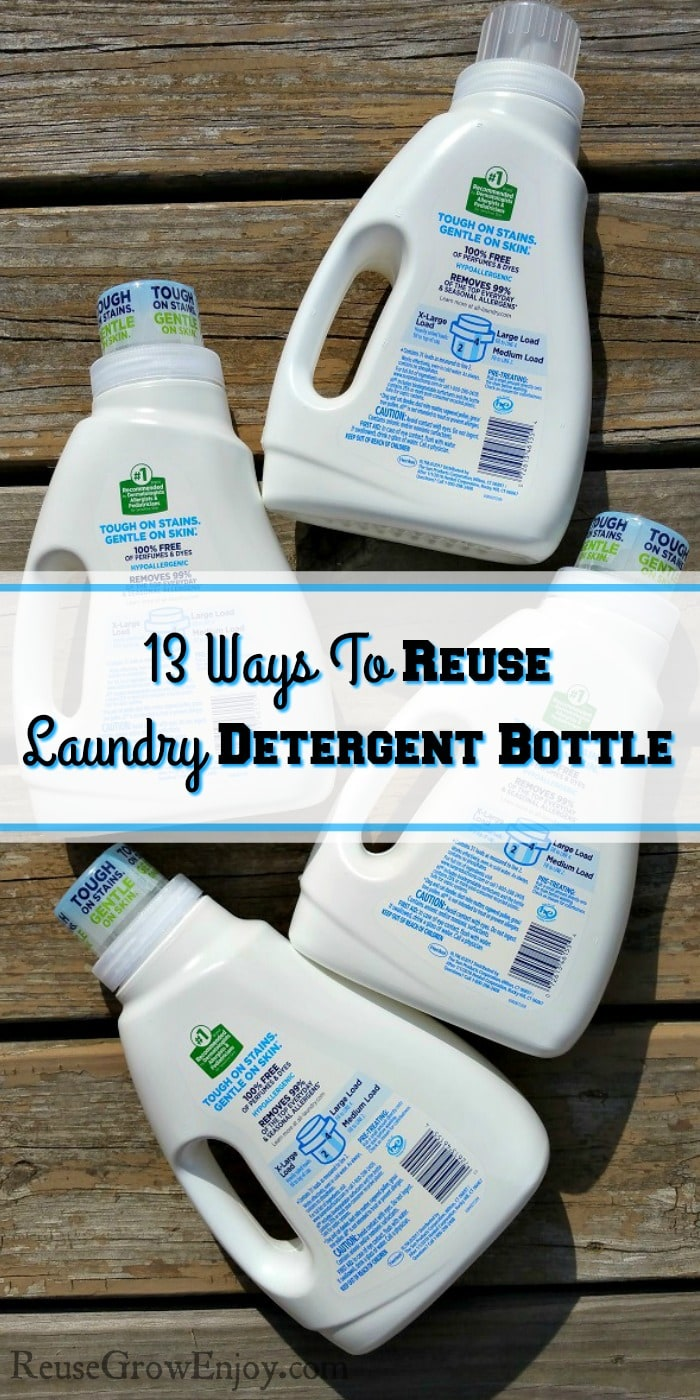 "Four white laundry detergent bottle laying flat on wood deck boards with a text overly that says ""13 Ways To Reuse Laundry Detergent Bottle""."