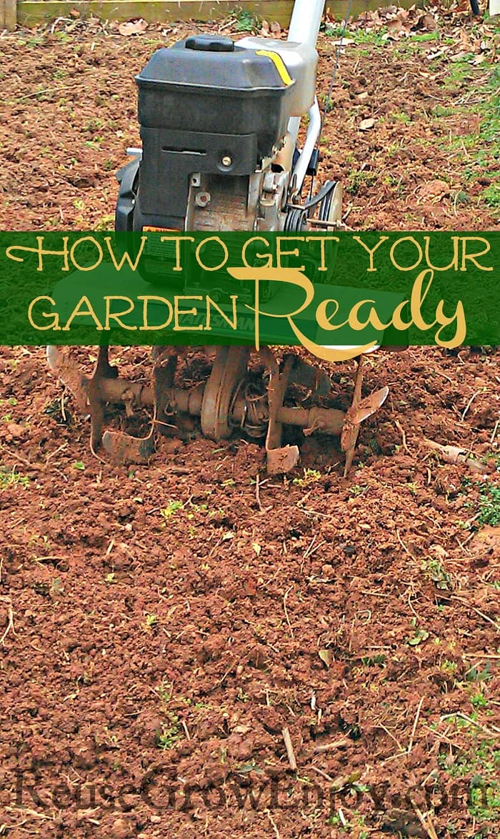 A tiller sitting in a freshly tilled up garden area with a text overlay in the middle that says