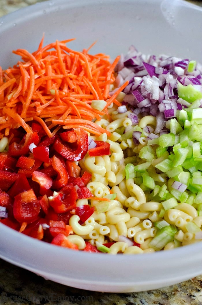 Mixing bowl with dices carrots, peppers, red onion and other things needed to make this recipe.