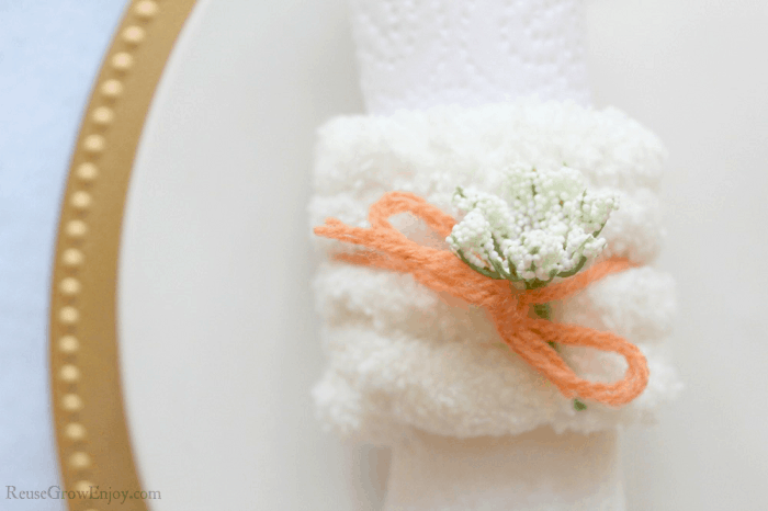 Flowers added to bow on napkin ring
