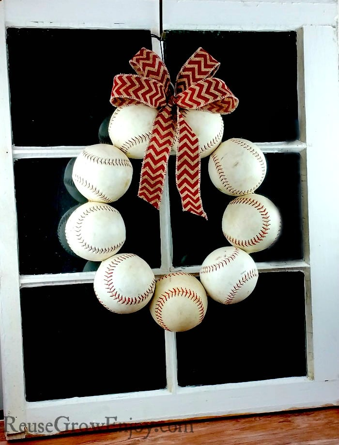 Need a new wreath for your door? If you like baseball, I have a project for you to try. It is a DIY Baseball Wreath - upcycled from old balls and a coat hanger.