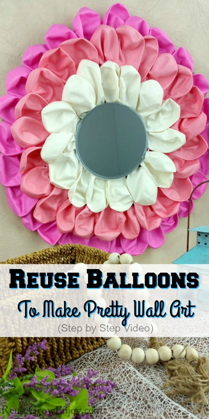 "Balloon craft wall art hanging on wall with mirror in center. Small basket with beads in front and a candle holder on right. Text overlay that says ""Reuse Balloons To Make Pretty Wall Art""."