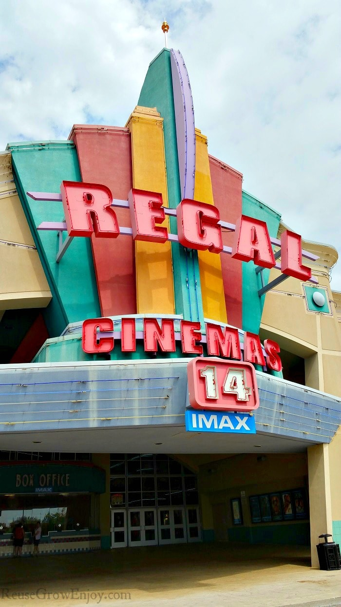 Box office Regal theater with summer movies on the posters.
