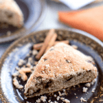 Cinnamon and Sugar Scone on a plate with others in the background.