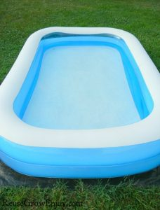 White and blue kids pool with clear clean water.