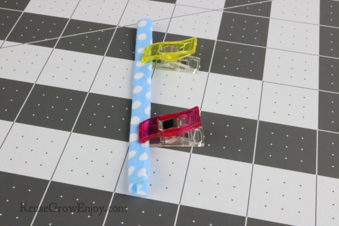 Clip folded fabric together