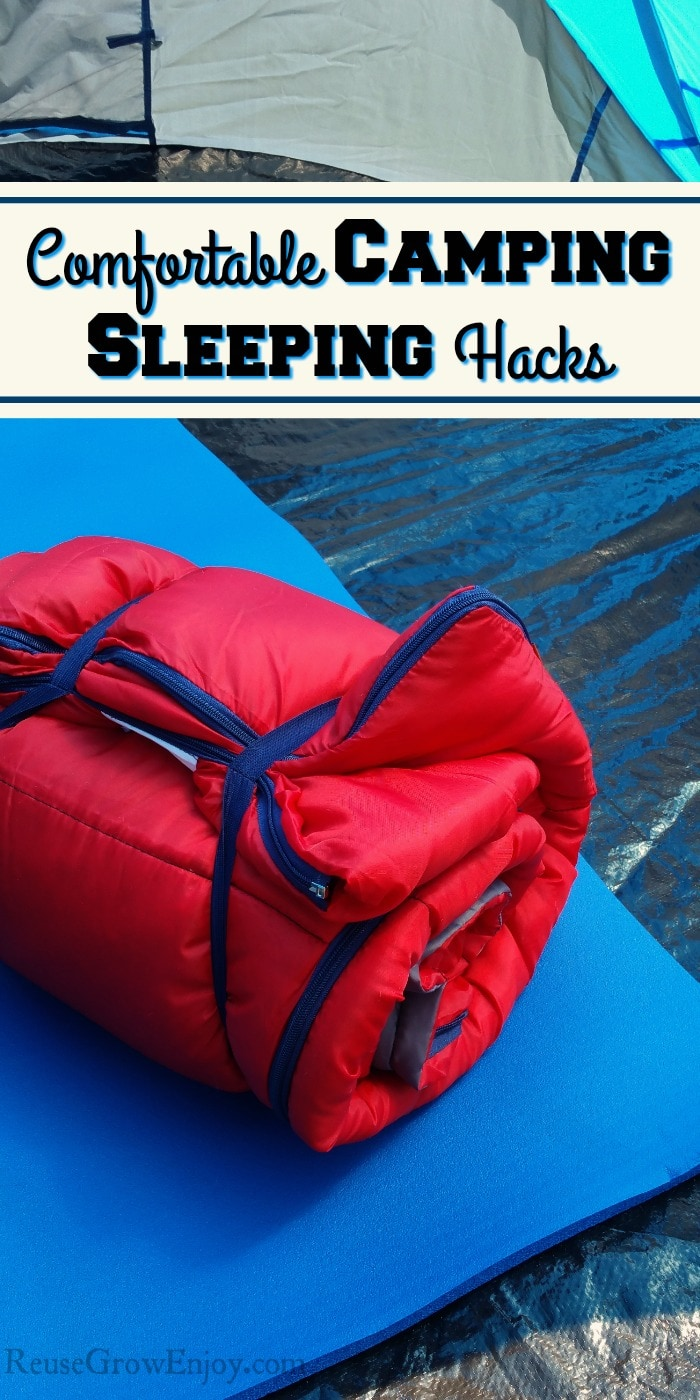 Red sleeping bag rolled up and laying on a blue foam mat inside of a tent. Text overlay says Comfortable Camping Sleeping Hacks.