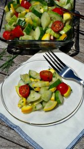 Have some garden fresh produce and looking for a new recipe to try? Check out my recipe for a squash cucumber tomato garden salad. Healthy, easy and tasty!