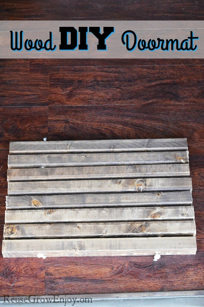 Need a new doormat? This is a nice easy DIY you can do. It is a wood DIY doormat.