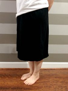 Women wearing the black dress upcycle into a skirt with a white shirt.