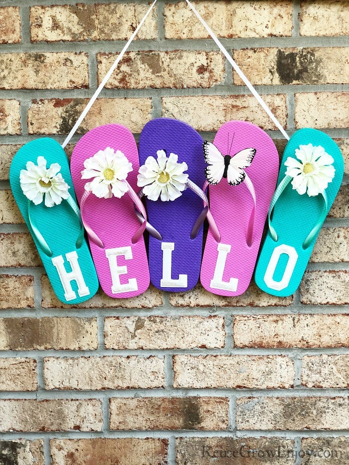 Summer flip flop sign with flowers and a butterfly
