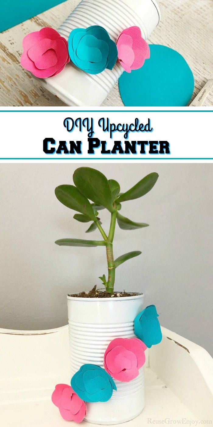 """Bottom half of picture is Upcycled can planter that is white with blue and pink paper flowers on it with plant inside. Sitting on a white wood shelf. Top part is paper flowers being attached to the can. In the middle there is a text overlay that says """"DIY Upcycled Can Planter""""."""