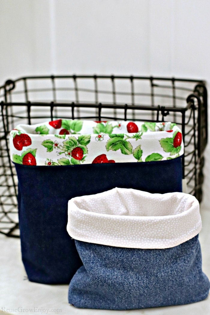 Two upcycled jean pouches and one black wire basket