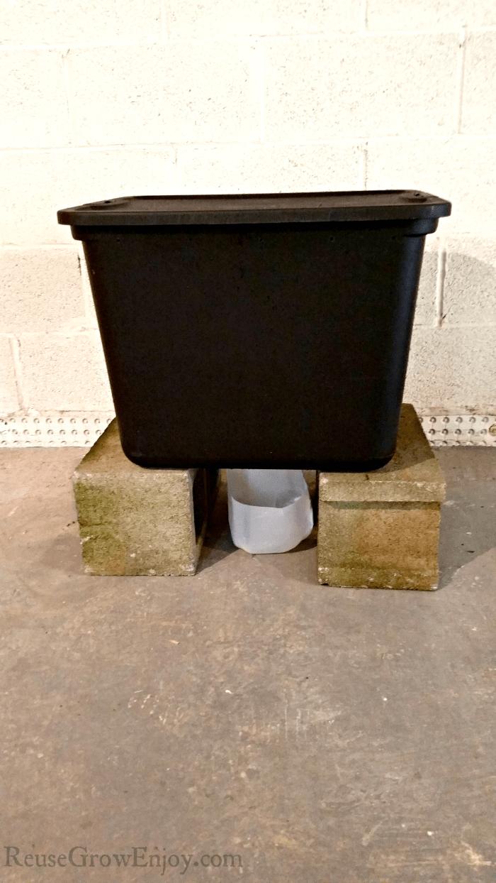 Worm composting bin sitting on blocks