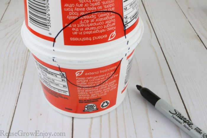 Containers stacked with a circle drawn on them