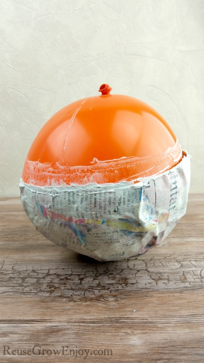 Fully dried paper mache bowl still attached to balloon.
