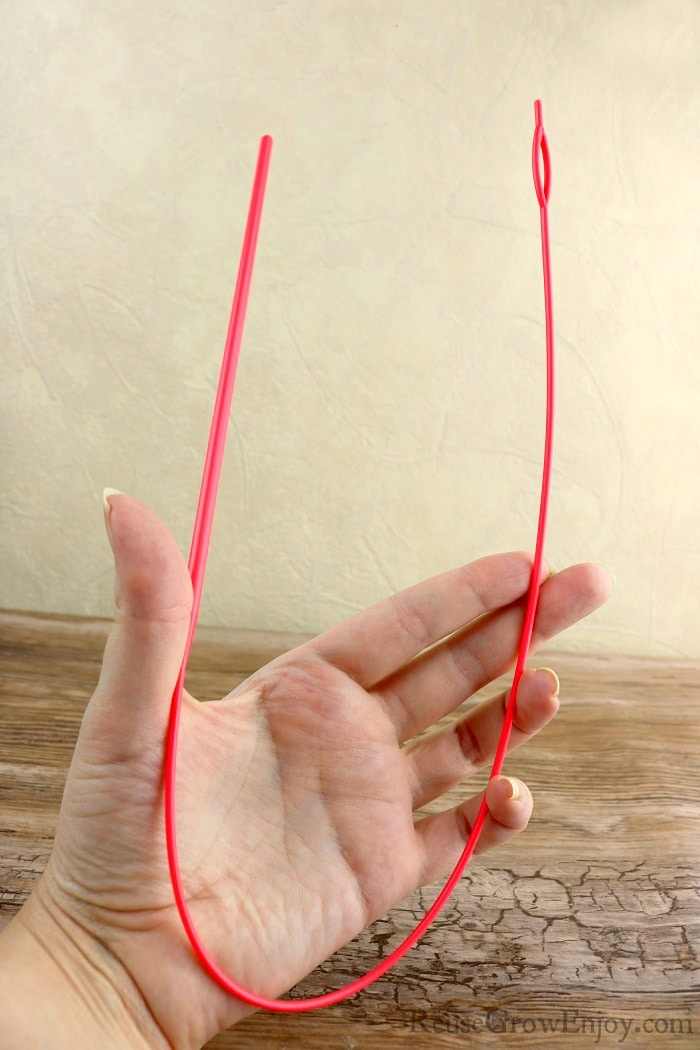 Hand holding an easy drawstring threader