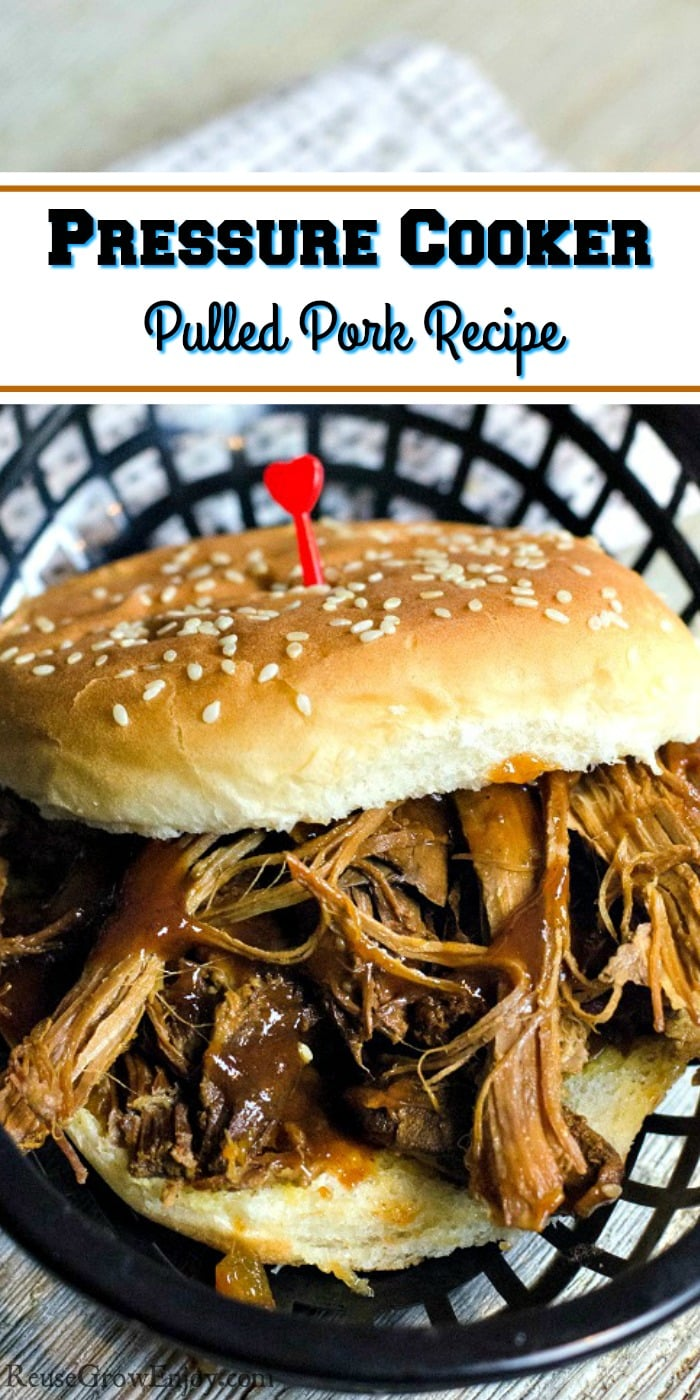 Pulled pork sandwich on a bun sitting in a black plastic basket with a cloth napkin under it and a wood background. Text overlay that says Pressure Cooker Pulled Pork Recipe.