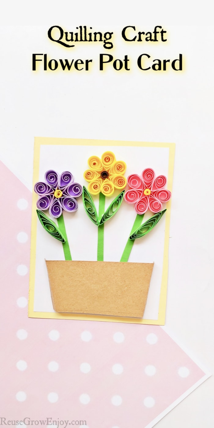 Quilled flowers on paper making a card. Text overlay at top saying Quilling Craft Flower Pot Card