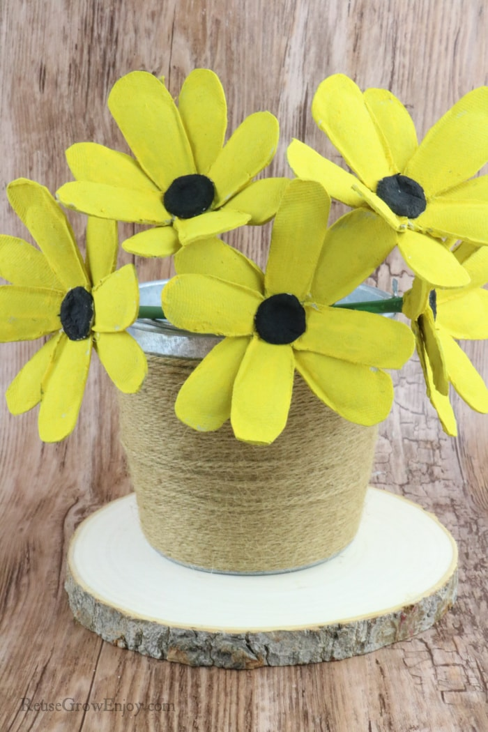 Finished black-eyed Susan flowers in metal bucket wrapped with twine