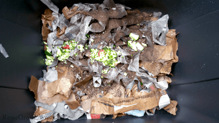 Paper, dirt and scraps added to the bin.