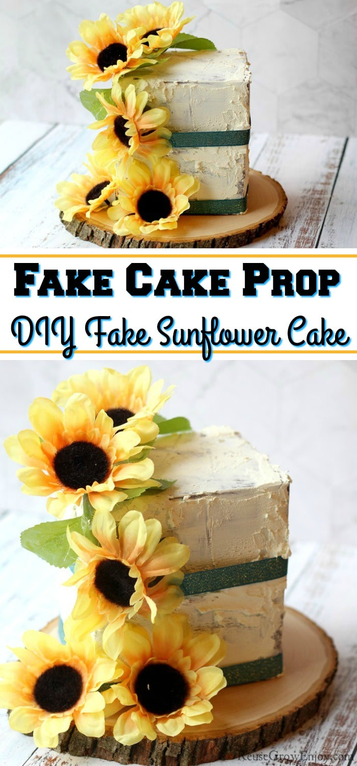 "A finished fake cake prop with sunflowers and green ribbon. It is on a wood slice. Text overlay int the middle that says ""Fake Cake Prop DIY Fake Sunflower Cake""."