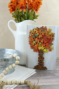 Fall home decor with fall tree made from puzzle pieces.