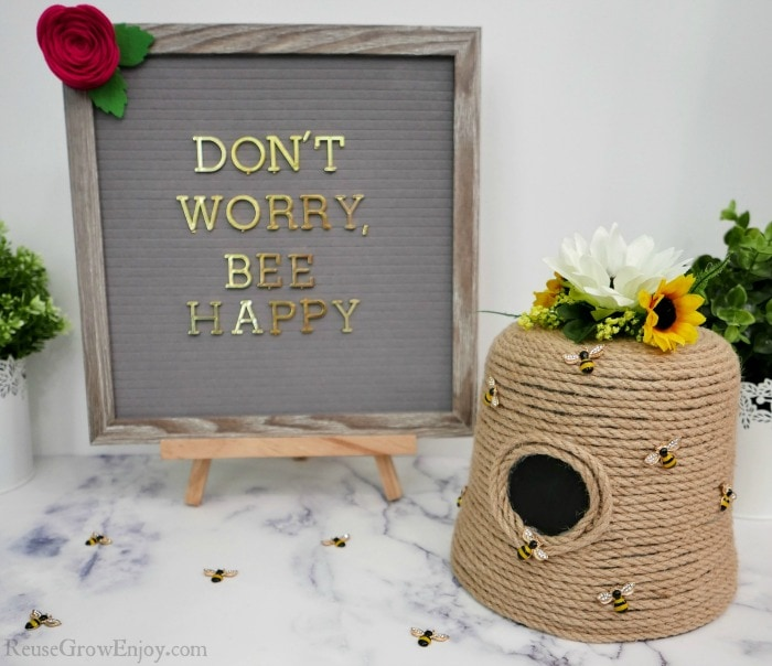 Finished Beehive craft with sign that says Don't Worry Bee Happy