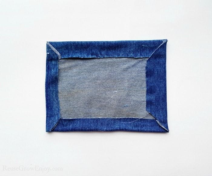 Fold edges of fabric