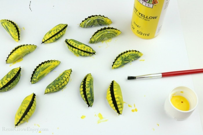 Folded caps being painted yellow