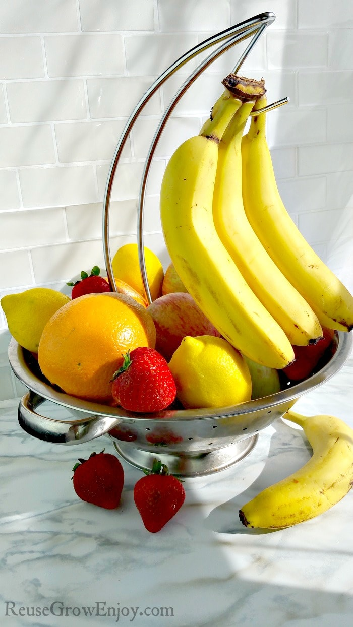 Need a fruit bowl with a banana hook but don't want to spend a lot on one? Check out this DIY fruit bowl display with banana hook. Super easy to make.
