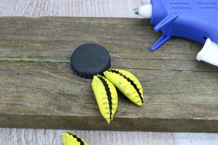 Glue yellow caps around black cap