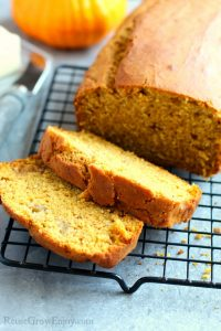 Sliced gluten free pumpkin banana bread on cooling rack.