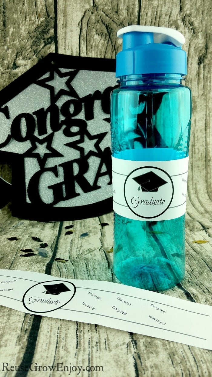 Having a graduation party? If you are looking for ways to carry the graduation theme through the party and are on a budget, be sure to check out this free Printable Graduation Water Bottle Label!