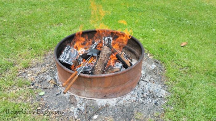 Heat pie iron over fire