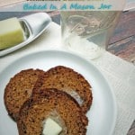 Slices of banana bread on white plate with mason jar and butter in background.