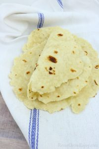 Homemade Flour Tortillas on white towel