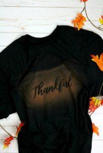 Black t-shirt with bleach print word thankful on it