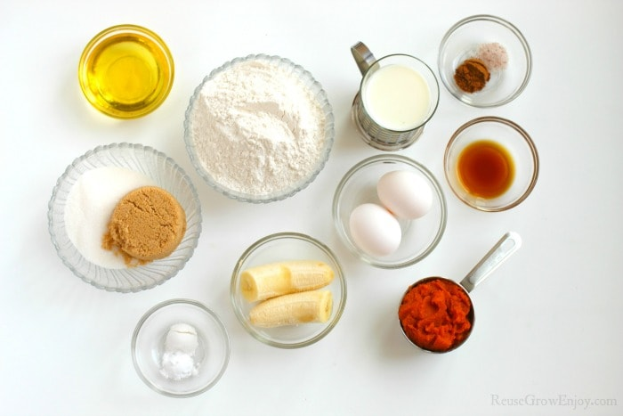 Ingredients in glass dishes to make Gluten Free Pumpkin Banana Bread