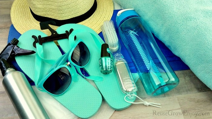 Items To Include In Mom Gift Summer Tote, Hat, Sunglasses, Flip flops and so on.