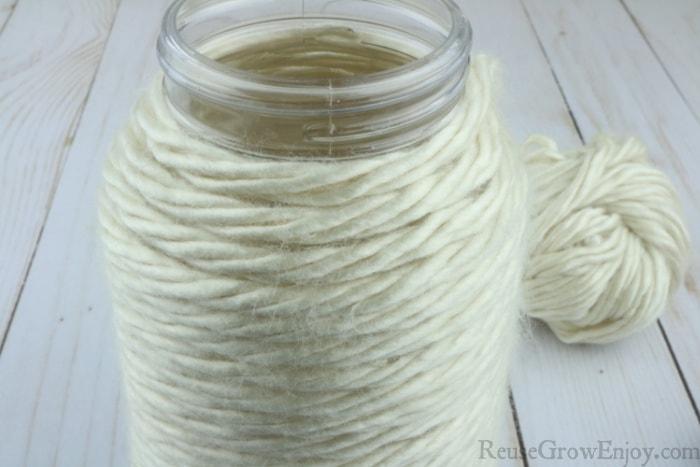 Jar covered in yarn