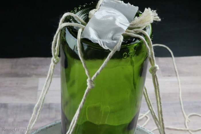 Make 4 knots around bottle