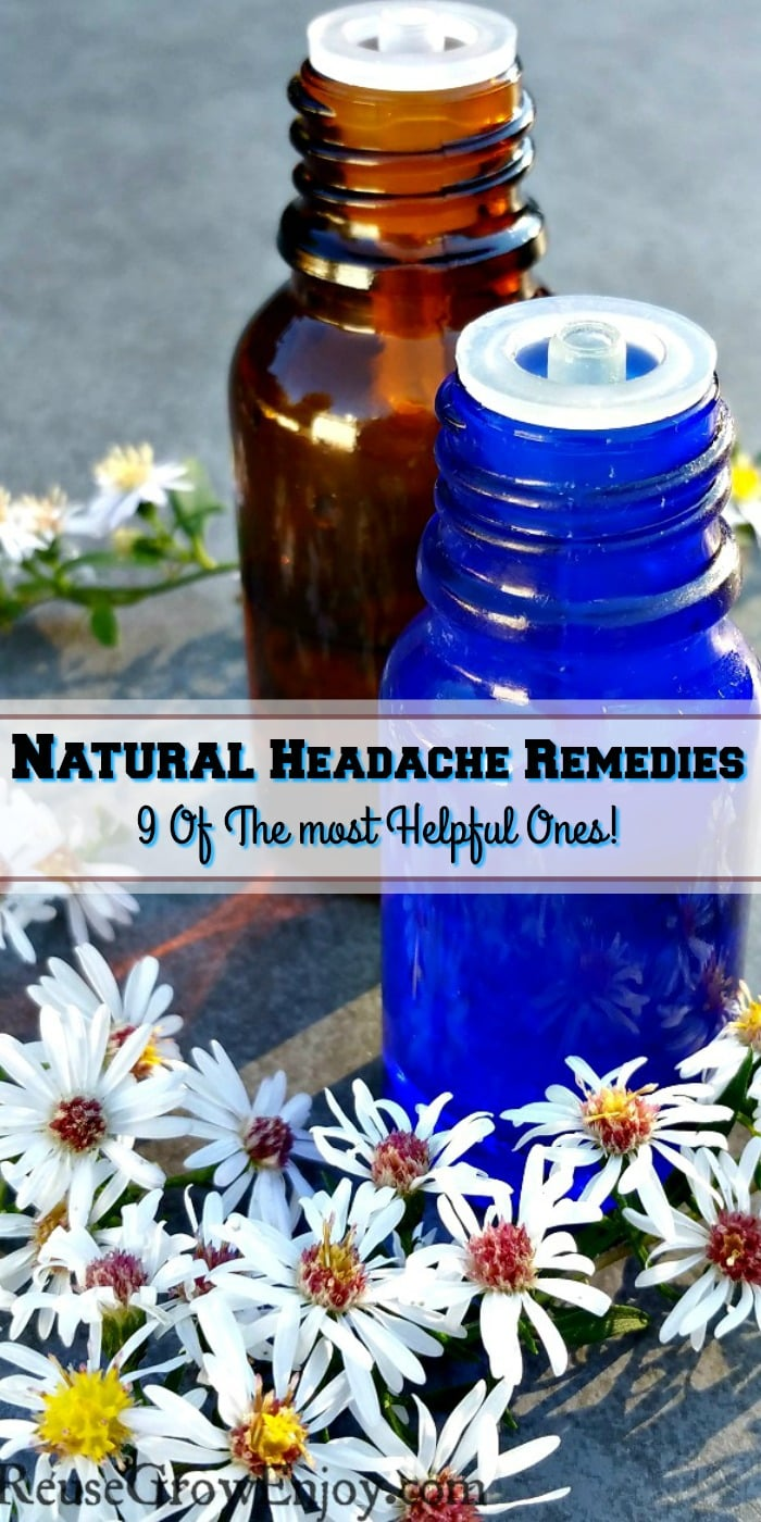 One brown and one blue small essential oil bottle with little white flowers all around them. Text overlay that says Natural Headache Remedies 9 Of The Most Helpful!
