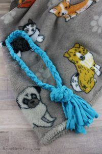 A blue rope dog toy made from old t-shirt