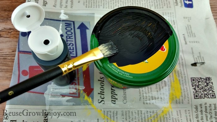Paint bush painting jar lid black