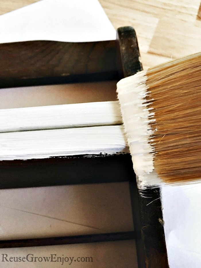 Then using your paint brush apply one coat of the chalk paint to the spice rack. While that was drying you can get the bottles ready.