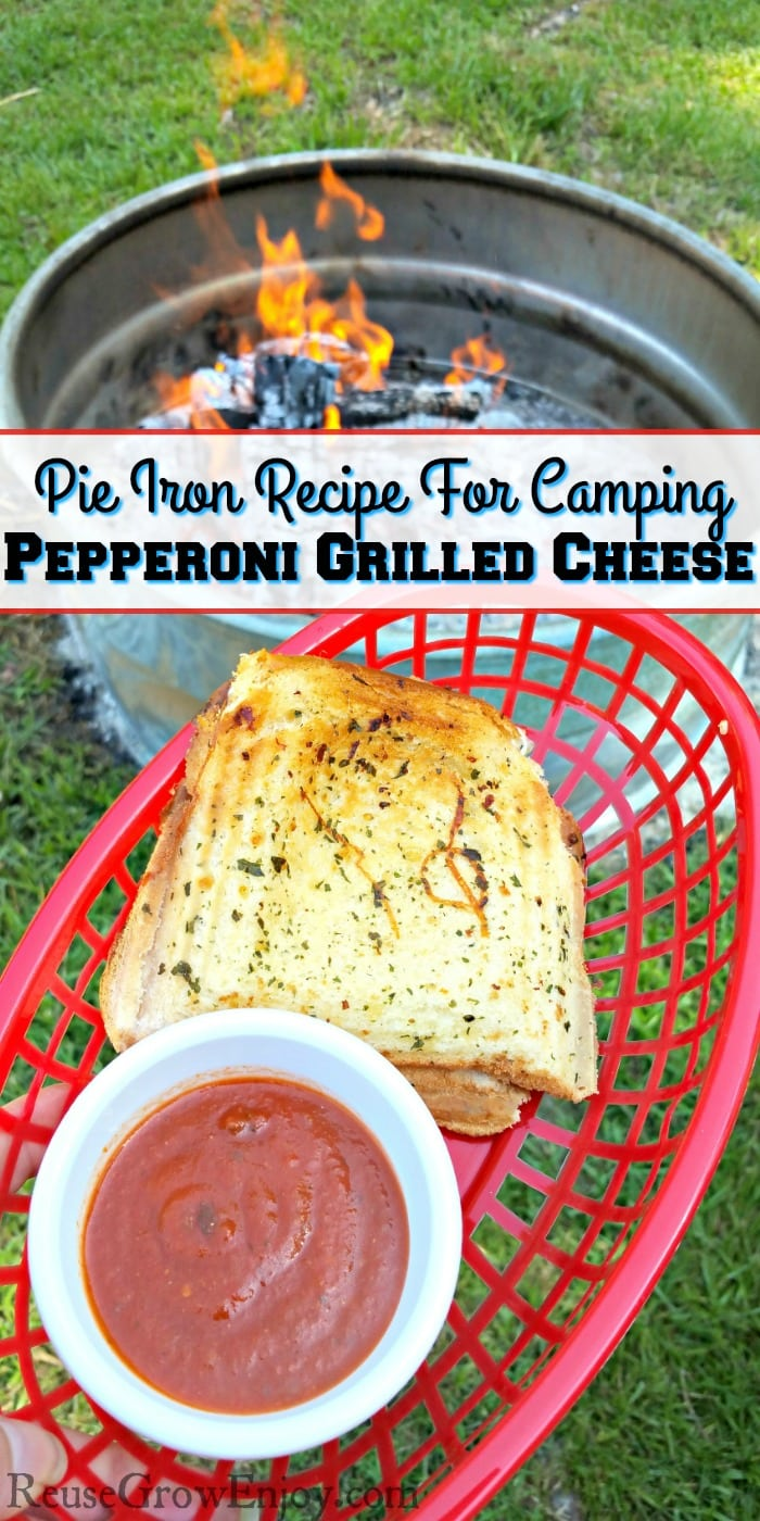 Pepperoni grilled cheese in red basket with a dish or red dipping sauce. Campfire in background. Text overlay that says Pie Iron Recipe For Camping - Pepperoni Grilled Cheese.