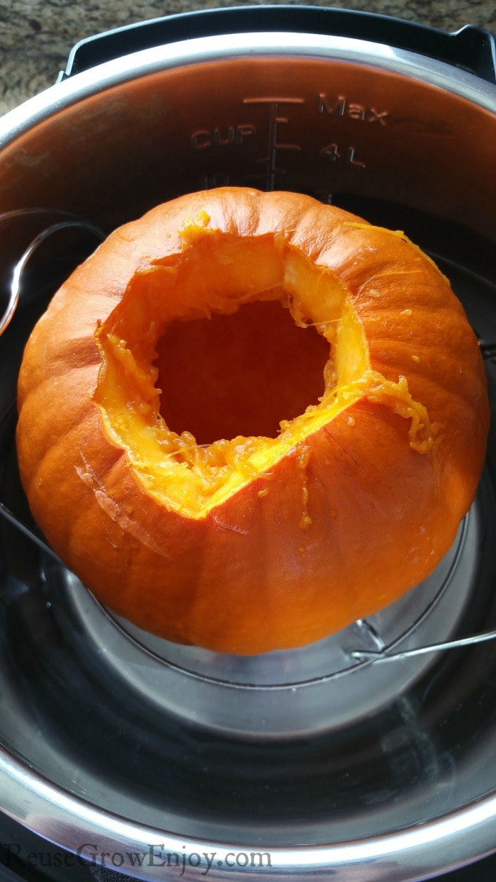 Cleaned out whole pumpkin sitting on a trivet inside of Instant Pot