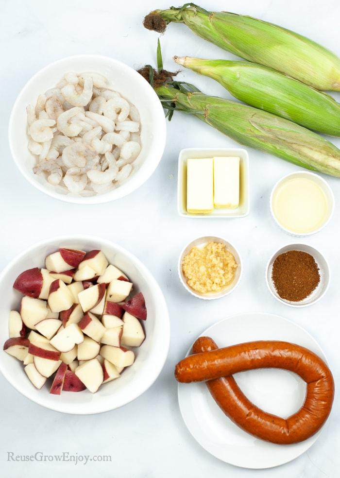 Potatoes, sausage, seasoning, butter corn and shrimp needed to make shrimp boil