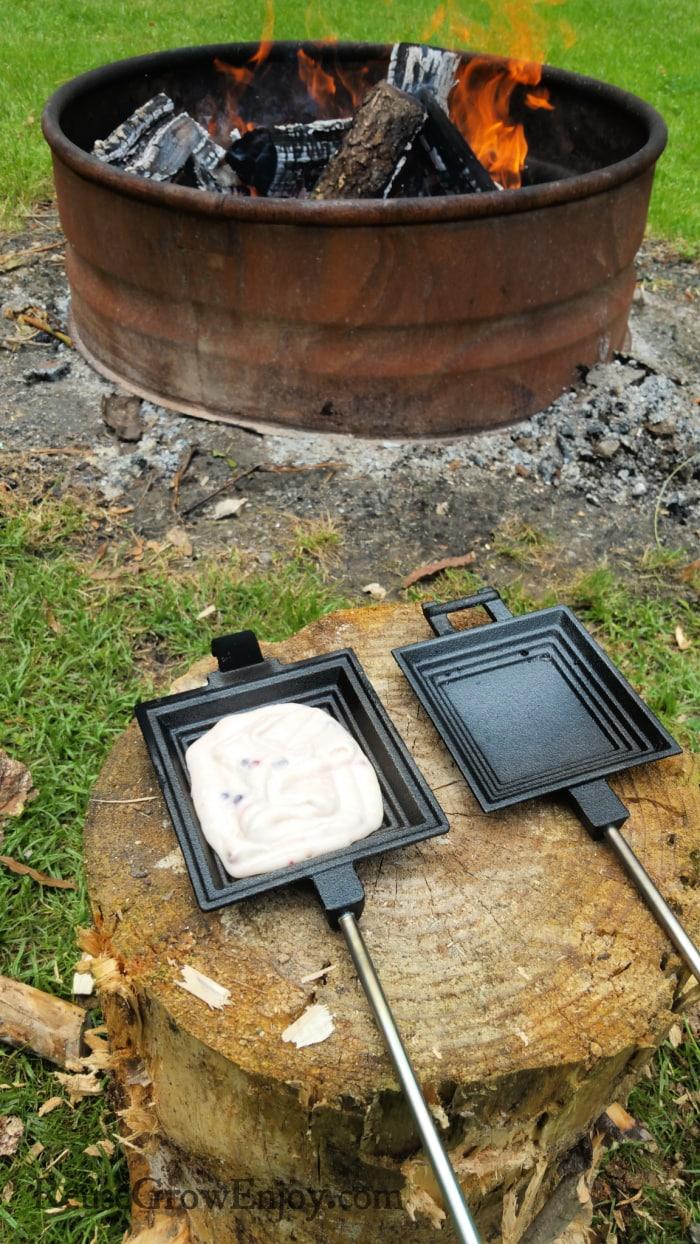 Pour batter into pie iron